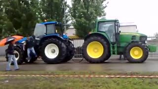 tractor power showing on road  - Video