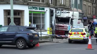 Recovery Truck Towing Bus After Crashing Into Shop's - Video