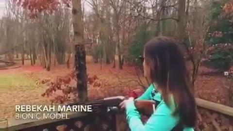 Rebekah Marine shooting a gun with her bionic arm!
