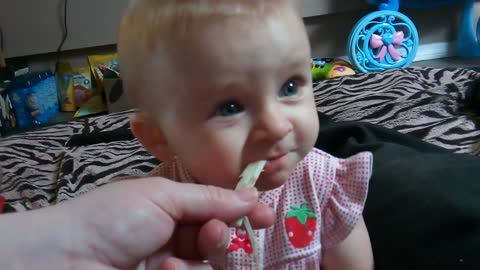 Cute baby's first time trying string cheese!
