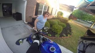 Sweet Lady Has Funny Reaction To Her Son's New Motorcycle - Video