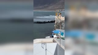 Man Fishes From Rooftop During Lockdown In Lanzarote