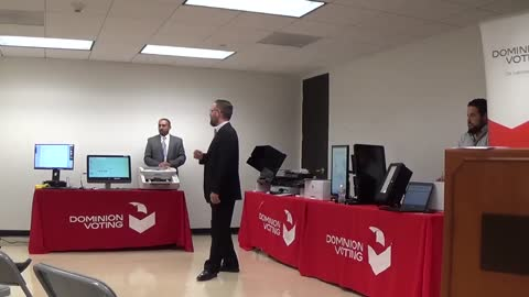 DOMINION EXECS AT VOTING EQUIPMENT EXPO EXPLAIN THEIR SYSTEM