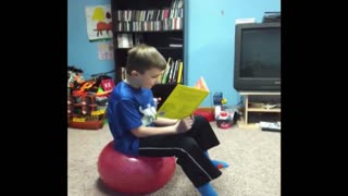 Reading Boy Surprised By Yoga Ball - Video