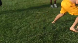 Guy blue shirt playing football and getting tackled  - Video