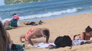 Man in red swim shorts push ups on beach  - Video