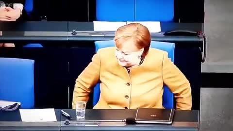 GERMAN CHANCELLOR ANGELA MERKEL SEEMINGLY 'FORGETTING' TO PUT HER MASK ON