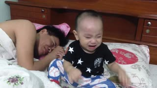 Baby crying because of father