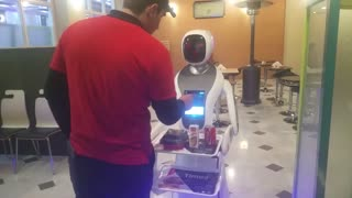 Robot Waitress Designed To Look Like Its Wearing A Hijab