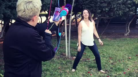 Girl Catches Rose Shot From Bow And Arrow In Mouth