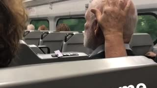 Woman rubs head of old man sitting next to her - Video