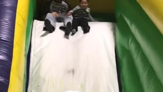 Collab copyright protection - boy falls green inflatable slide