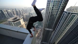 Spiders in Dubai: 1. High Rise Hand Stand/ 2. Climbing a Building from a Dead Drop Off - Video
