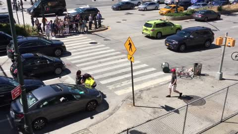 Driver and Cyclist Fighting in the Street. Police Break it Up.