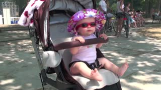 Cool baby dances in a stroller