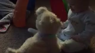 Mechanical toy puppy sends baby into laughing fit