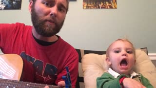 Baby hilariously sings along to dad's guitar-playing