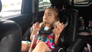 Little girl struggles to stay awake during favorite song - Video