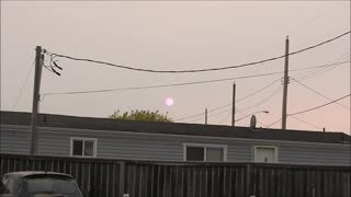 Awesome zoom-in of pink sun with sunspots  - Video
