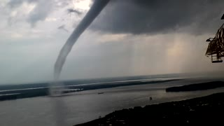 Waterspout Swirling Near Crane Operator - Video