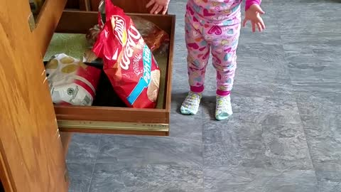 Little Girl gets caught sneaking Chips