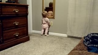 Baby girl fascinated by her reflection - Video