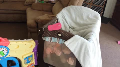 Toddlers playing peek-a-boo