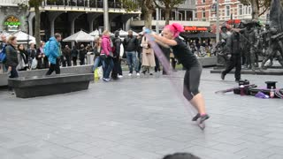 Street performer moves in a big ring in Amsterdam