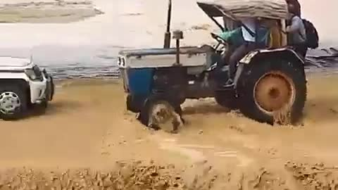 This Tractor Driver Driving through flood water dangerous driving