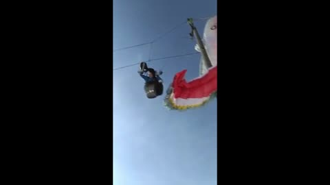 Paraglider gets stuck in telephone wires