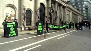 Climate activists spray paint on Bank of England