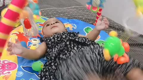 Cute Baby playing with her Toys!