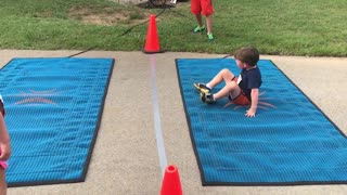Adorable Little Boy Hilariously Struggles To Crawl Across Finish Line - Video