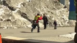 Red jacket carrying yellow pants kid