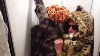 Guy in leopard fur sweater inside fridge  - Video