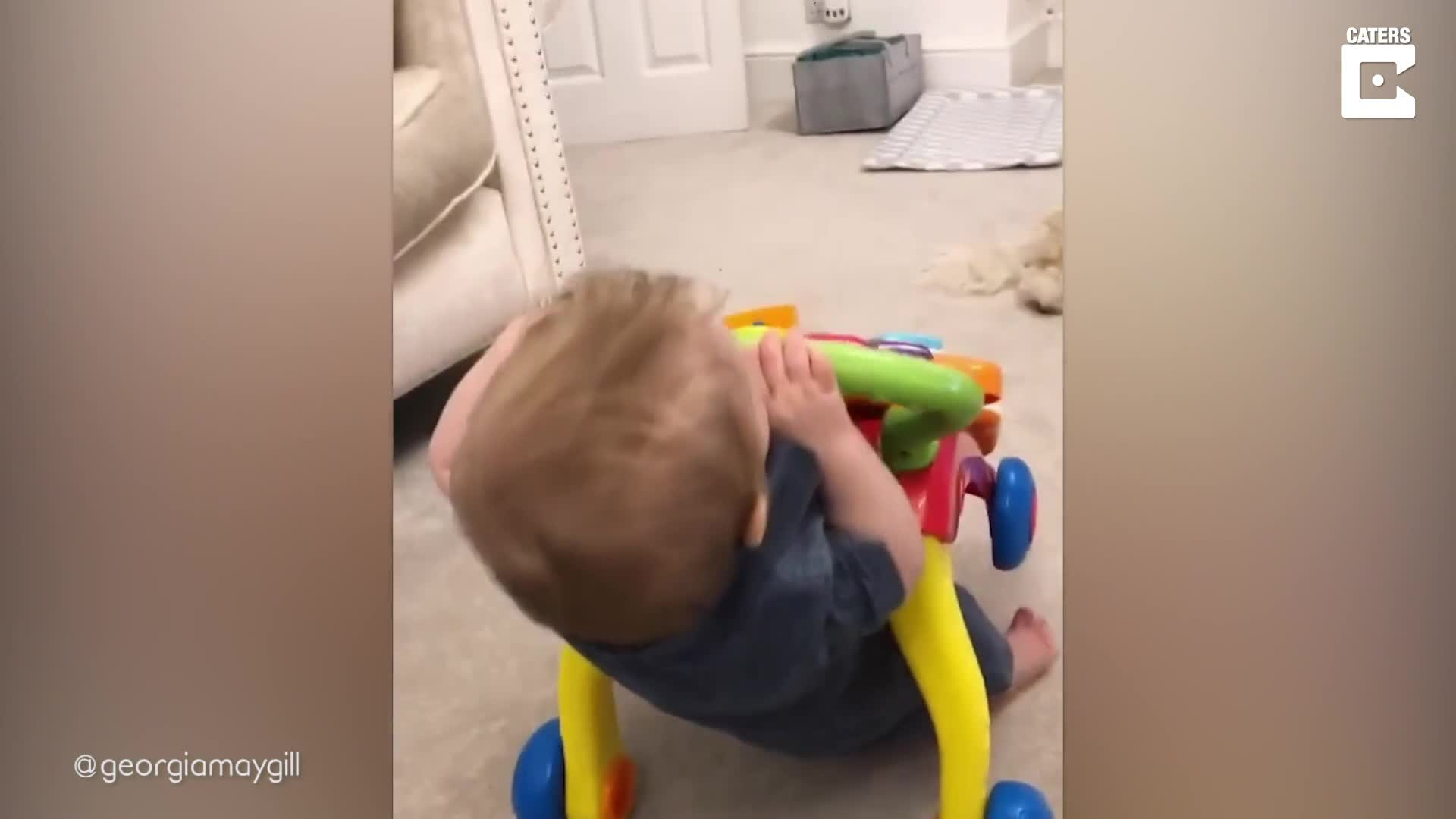 CUTE ONE-YEAR OLD BOY TAKES A TUMBLE BACKWARDS IN ADORABLE FAIL VIDEO