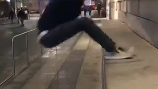 Guy in black jumps on concrete falls back - Video