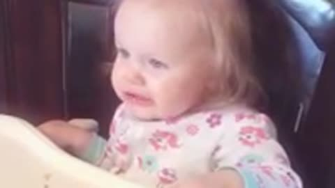 Baby has conflicting emotions after tasting orange juice