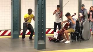 Guy yellow shirt dancing to violin duo subway - Video
