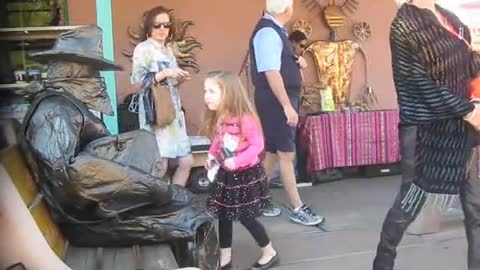 Living Statue Spooks Woman and Child