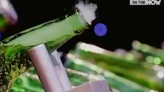 Man opens beer bottles with air rifle shot - Video