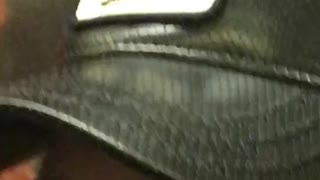 Zooming in a mans hat that says cock - Video