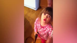 Little Girl Practices Make Up On Dog - Video