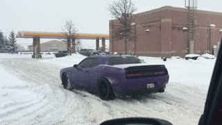 Challenger Sliding Into Gas Station