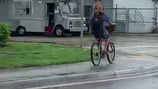 Dog Hitches a Ride on Bicycle Riders Back
