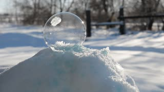 See The Magical Moment When A Soap Bubble Completely Freezes