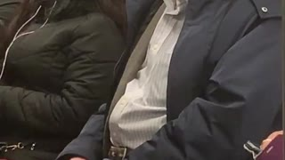 Old man on subway train sings opera out loud