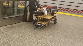 Piano man plays wedding song on the subway terminal - Video