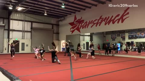 Gymnastics routine guy in checkered pants falls