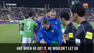 That young boy just doesn't want to leave Messi's hand